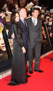 Japanese fans go wild for Brangelina at the Tokyo Premiere of 'The Curious Case of Benjamin Button. Fans queued for hours before the premiere of Brad Pitt's Oscar nominated film. Angelina Jolie was happy to sign autographs and wave at fans. She was wearing a form fitting, body hugging black dress as she glided down the red carpet in Tokyo, Japan.